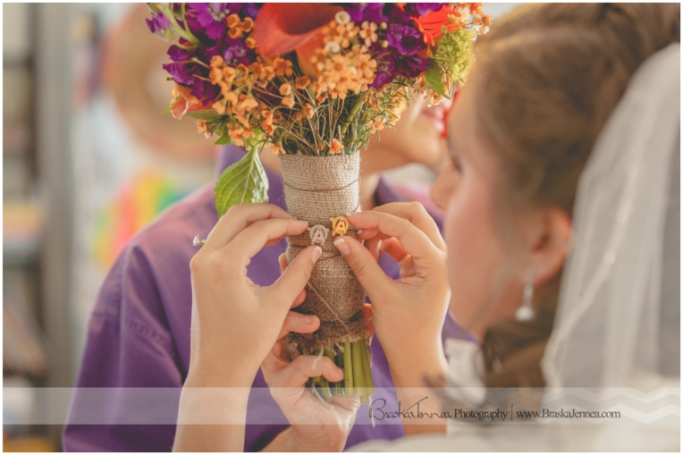 Pinning her maid's sorority pins to her bouquet!